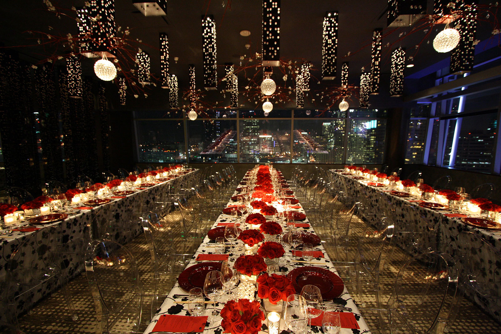 Dining space decorated with red roses at an AOO event