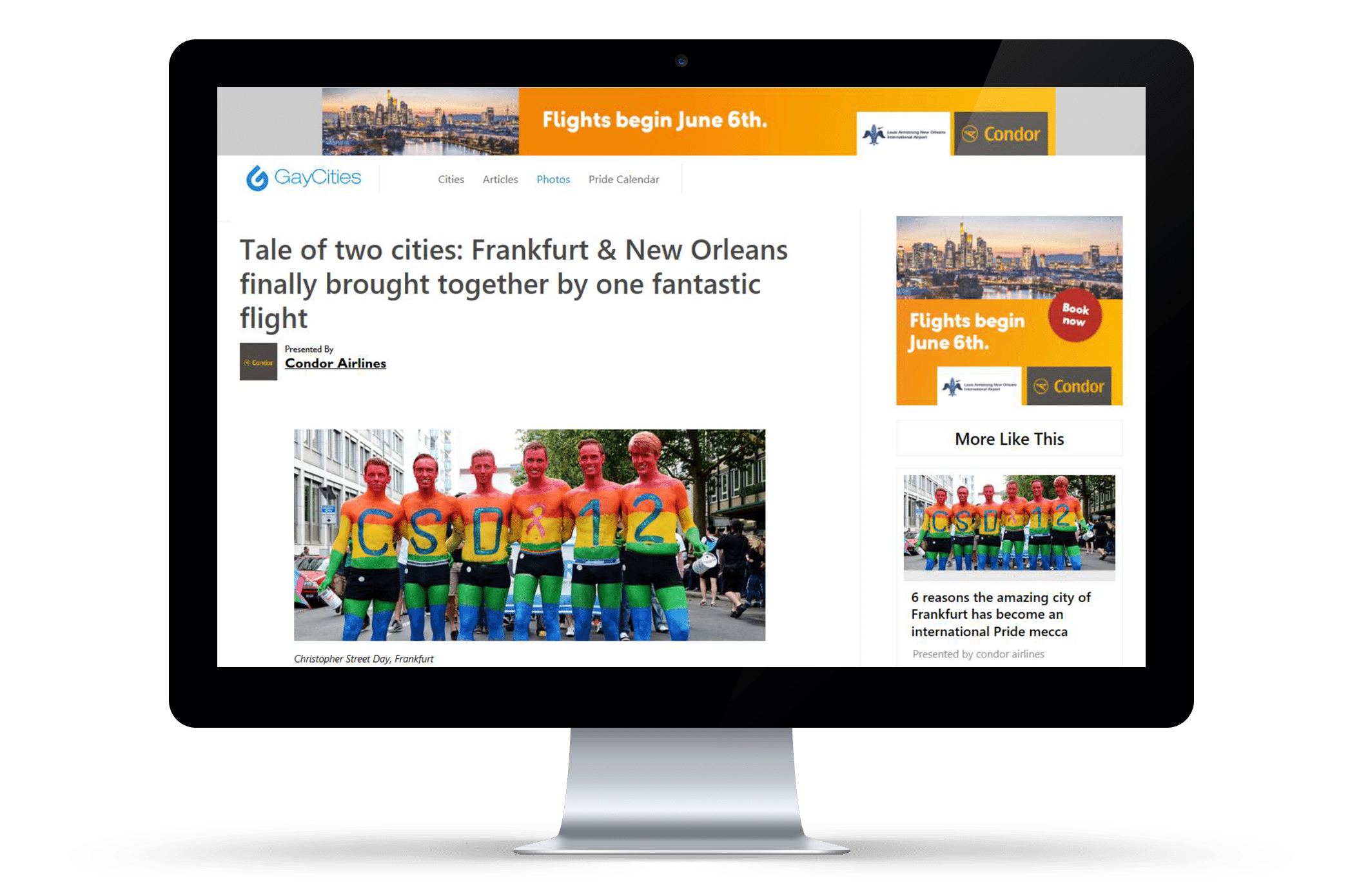 Computer monitor with a web browser open to Gay Cities' article about Condor's sponsored pride parade float