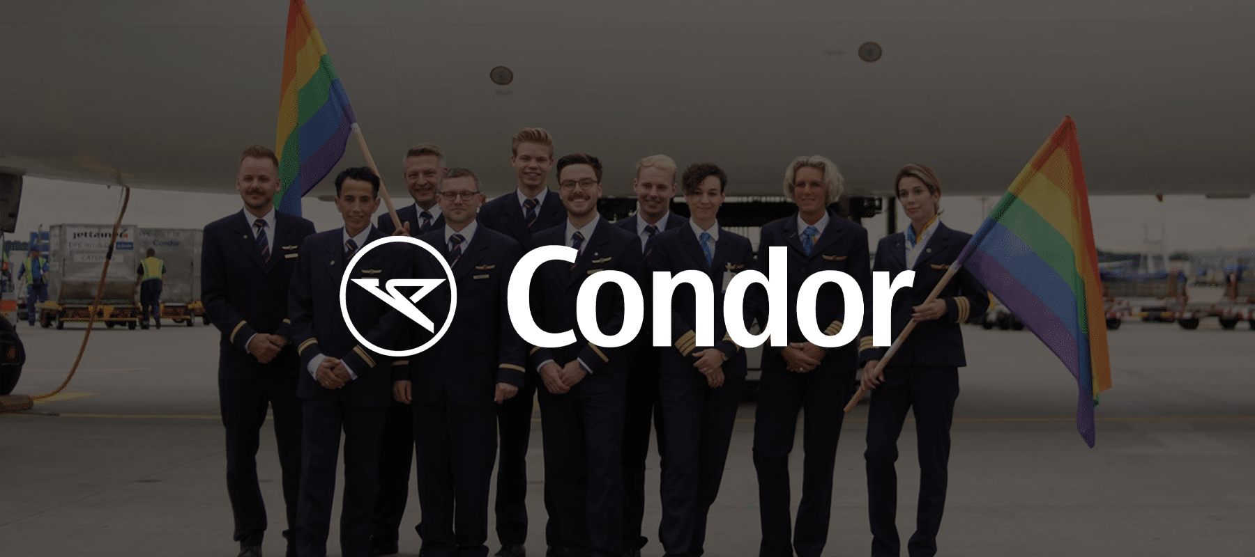 The Condor airlines logo superimposed over employees holding LGBTQ pride flags